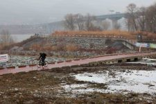 A rider riding through the snow on the Hangang Bike Path.