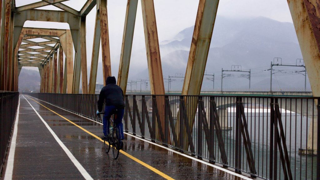 A picture of a bike rider on the Bukhangang Bridge outside of Seoul.