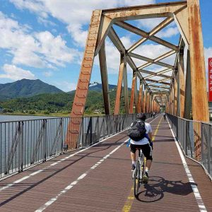 A rider crosses the Bukhangang Bridge on the Hangang Bicycle path in Korea.