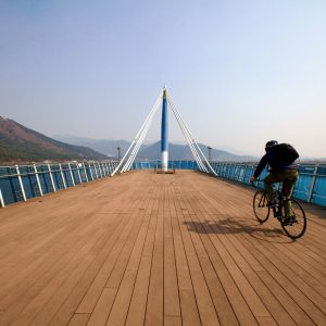 A cyclist cruises down the Dalseong-bo (달성보) near Daegu in South Korea.