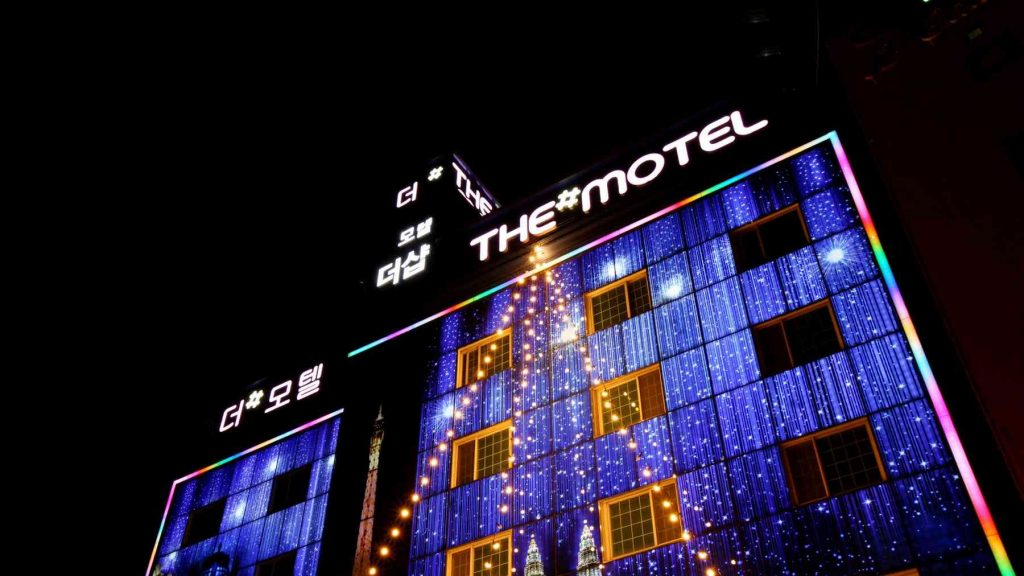 A picture of an illuminated love motel in South Korea.
