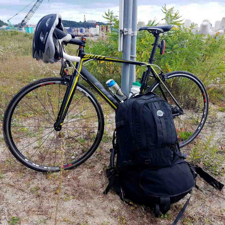 A picture of a bike and an over-sized backpack.