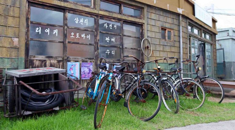A photo of an old bike shop in a historic village in Korea.