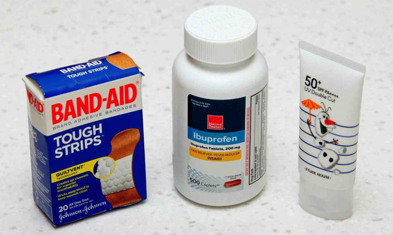 A picture of ibuprofen, band-aids, gauze, face masks, and sunscreen.