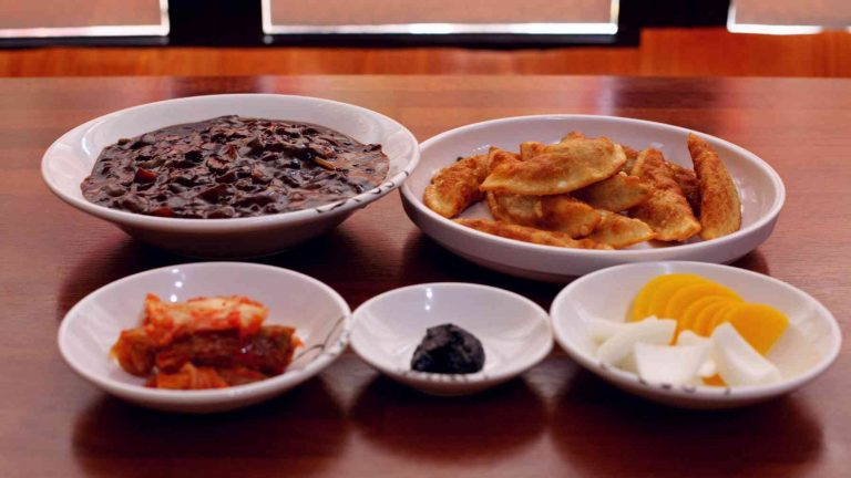A picture of a bowl of jajangmyeon.