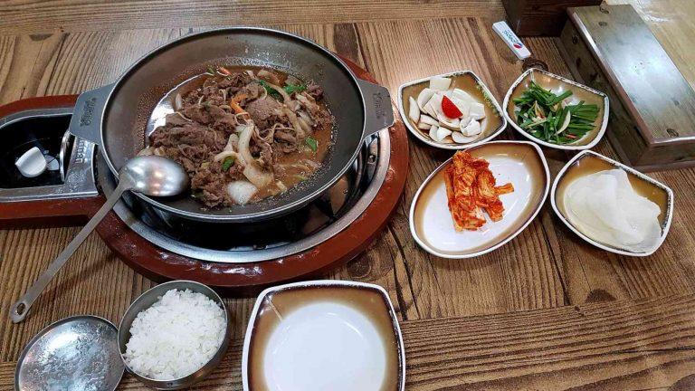 A picture of bulgogi cooking in a pot in a restaurant in Korea.
