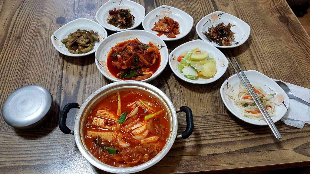 Shows a typical kimchi jjigae set-up.