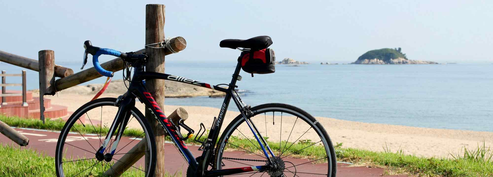 A picture of a bike and small island near the city of Sokcho in Korea.