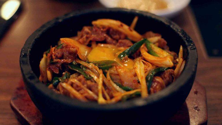 A picture of Bibimbap (비빔밥) in a stone pot in Korea.