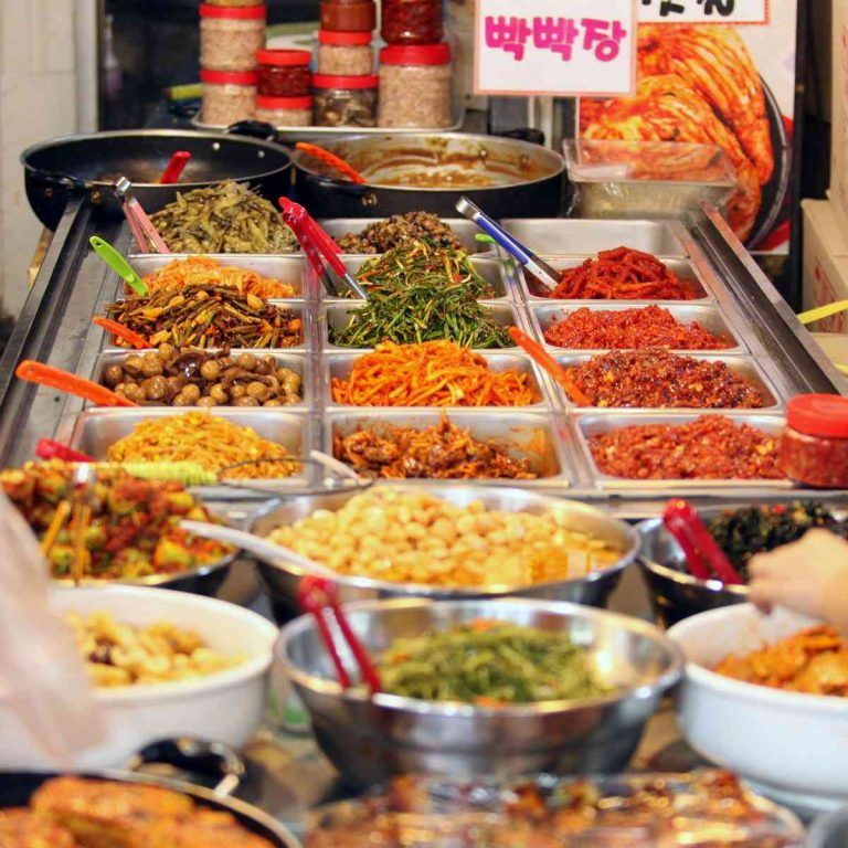 A picture of kimchi and side dishes at a traditional Korean market.