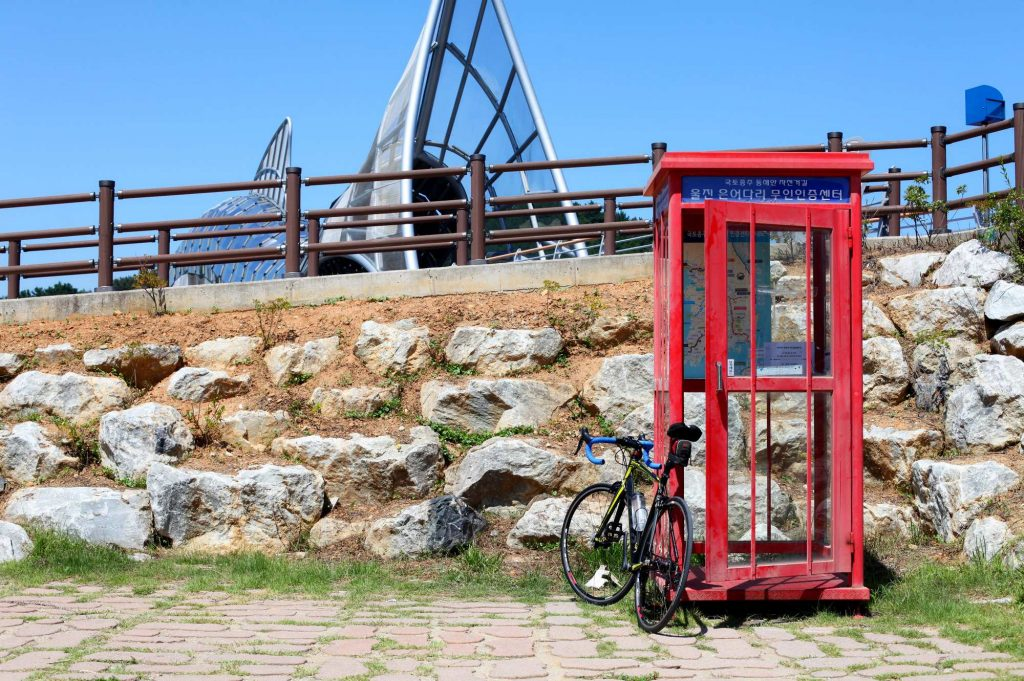 A bike leans against the checkpoint booth near the Uljin Sweet Bridge on the East Coast bicycle path in Korea.