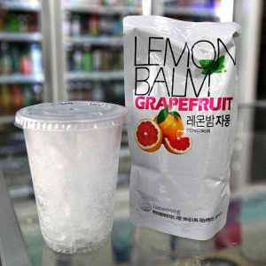 A picture of a pouch drink and cup of ice from a Korean convenience store.