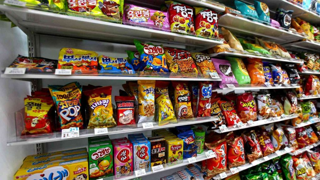 Shelves full of potato chips at a convenience store in South Korea.