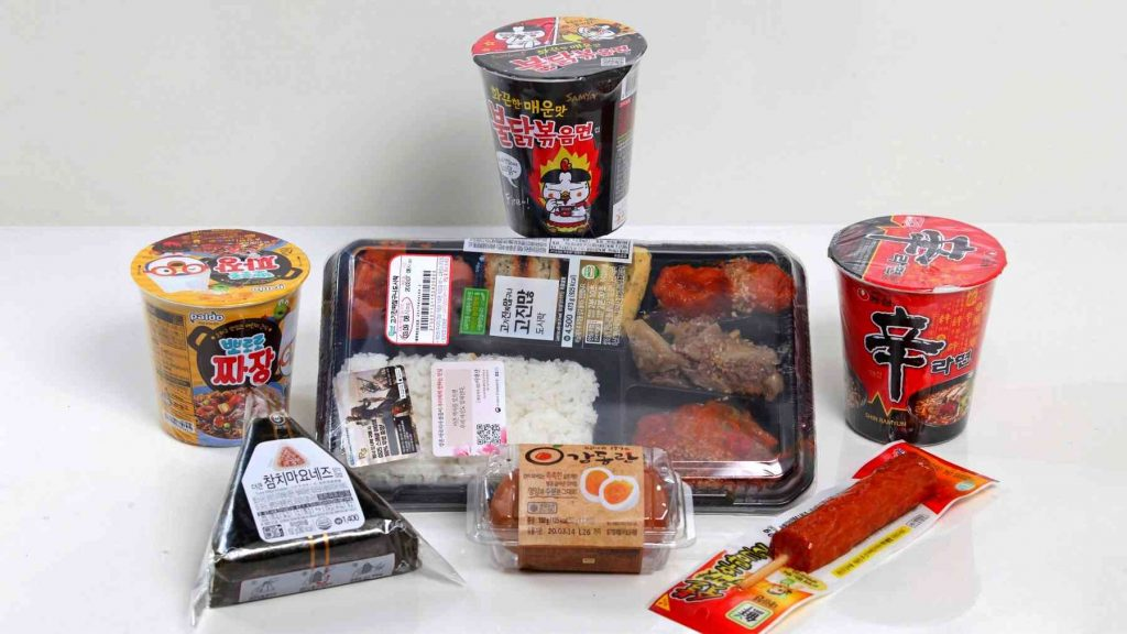 A picture of ramen, lunchbox, eggs, triangle gimbap, meat on a stick, and more food from a convenience store in Korea.