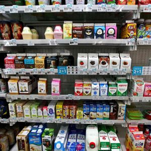 Shelves of milk and coffee options in a convenience store in South Korea.