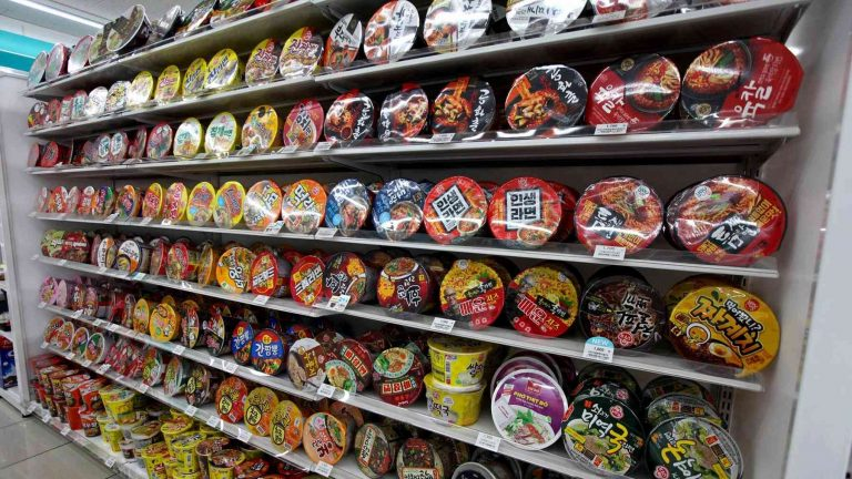 Shelves full of instant ramen at a convenience store in South Korea.