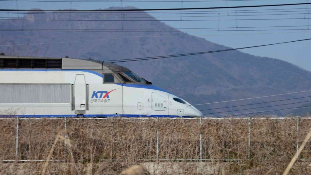 A picture of the KTX train near the city of Yangsan in South Korea.