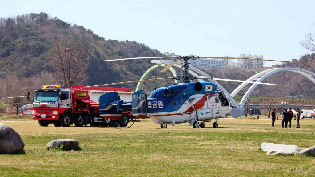 A picture of emergency helicopters filling with water in a city park in Ulsan, South Korea.