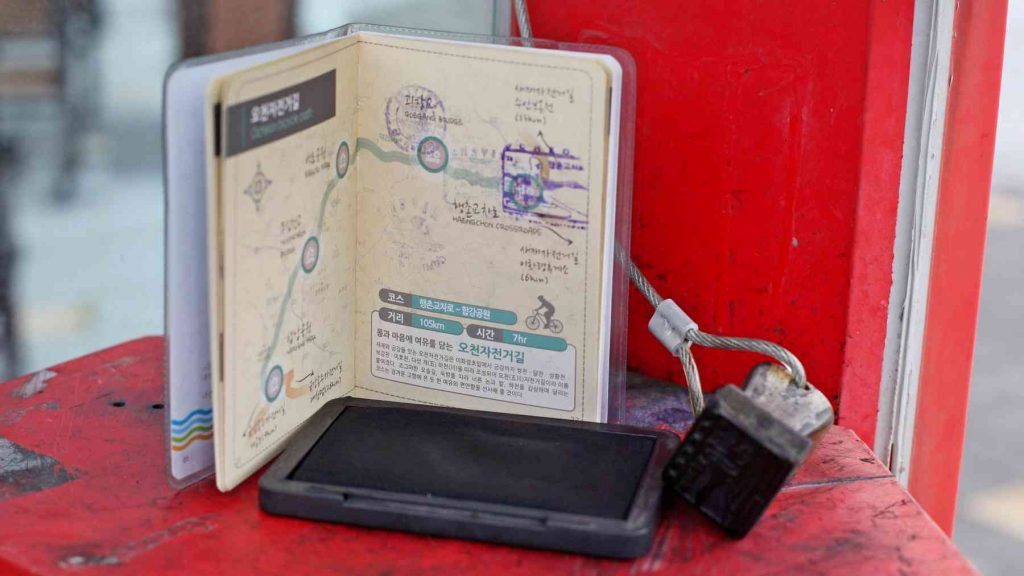 A picture of a bike passport book and stamp in a checkpoint booth.