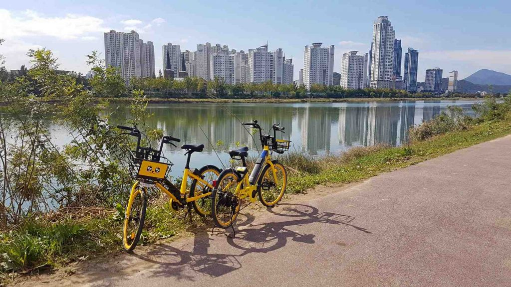 A picture of a Kakao-T bike parked near Taehwa river in Ulsan, South Korea.