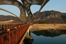 A walking bridge to an island park on the Nakdonggang Bicycle Path in South Korea.