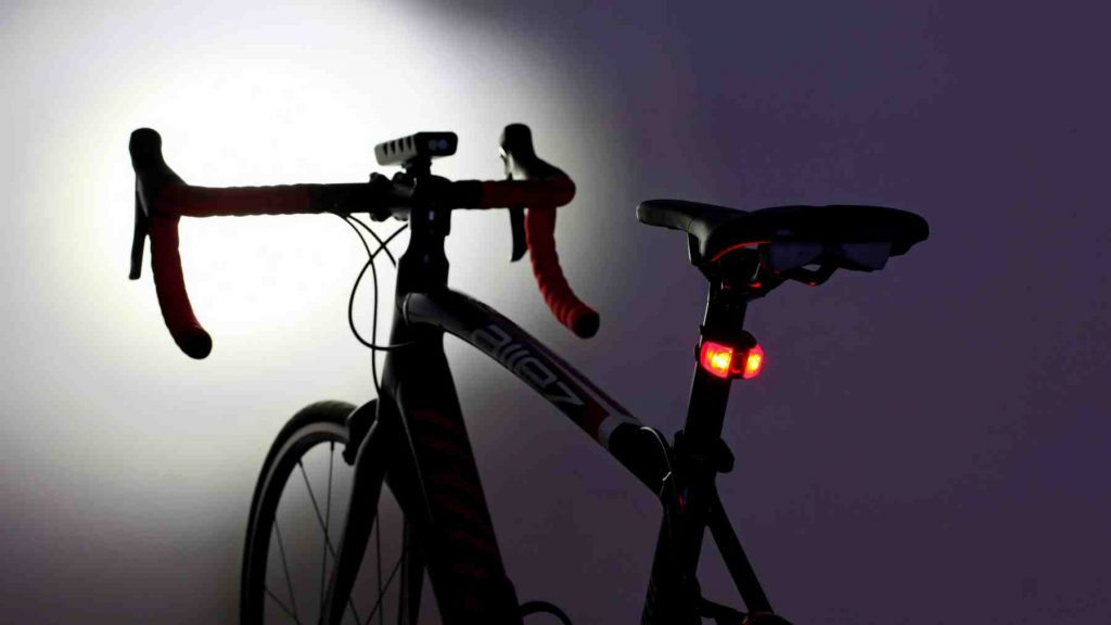 A picture of front and rear bike lights mounted on a bike.