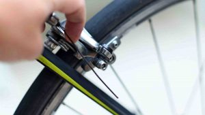 A picture of a bike's brake cable released from its bolt.