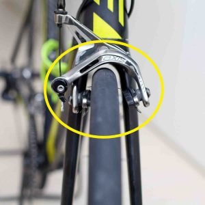 A picture of brake misaligned calipers on a bicycle.
