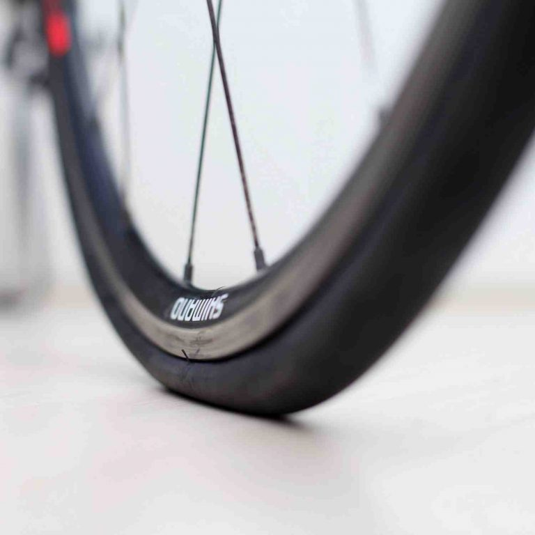 A close-up picture of an inflated bicycle tire.