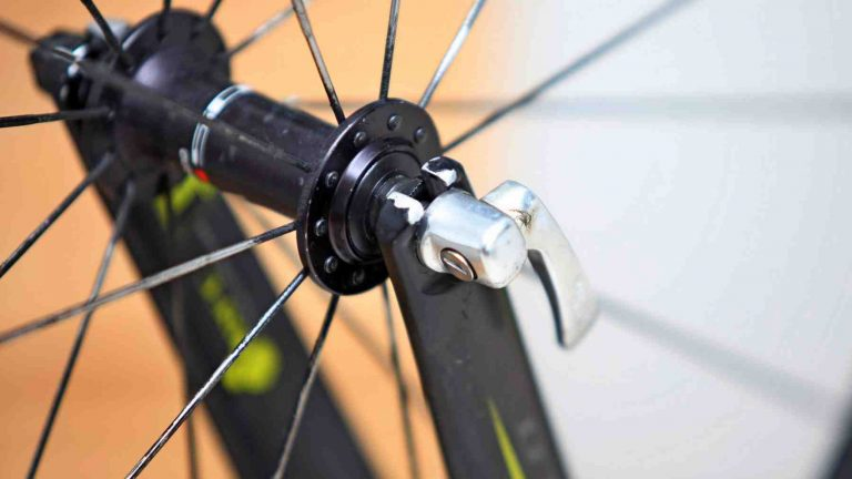 A close-up of a wheel's quick release latch on a bicycle.