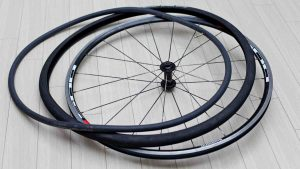 A picture of a bicycle's clincher style wheel:, including its tire and tube.