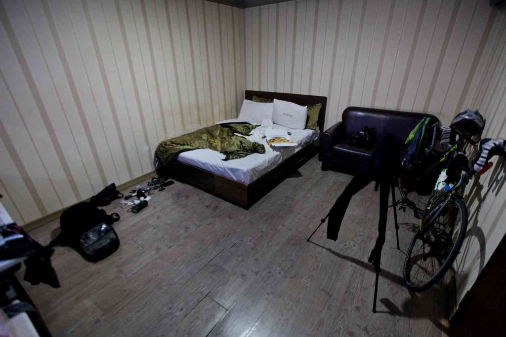 A picture of a motel room and bed in South Korea.