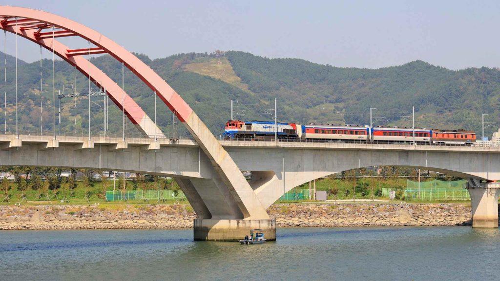 A train crosses a bridge in Gwangyang City along the Seomjingang Bicycle Path.