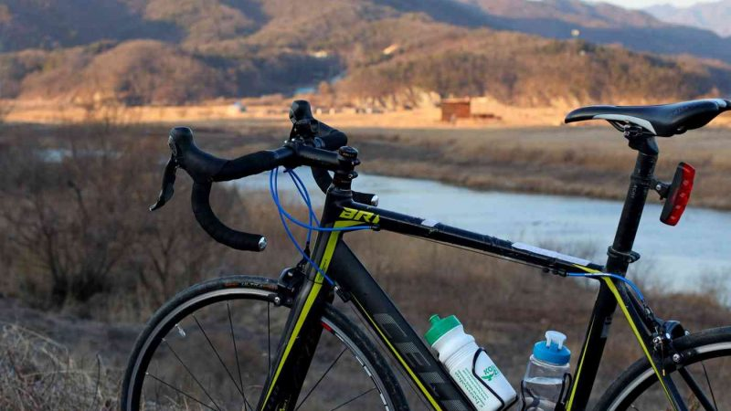 A bicycle sits near a hill along the Hangang Bicycle Path near the city of Yeoju.