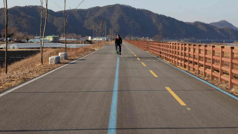 A rider rides down a bike path near Yeoju, South Korea.