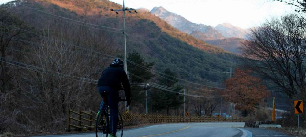 Saejae-Bike-Path-Chungju-Sangju-Rider-Mountain-Sunset-1