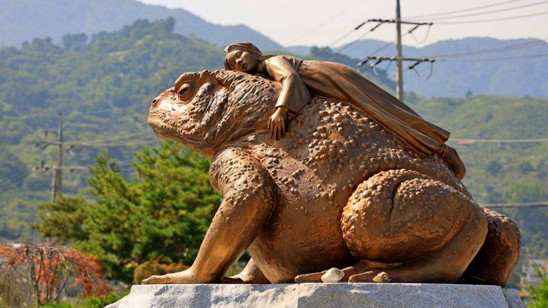 Seomjingang Bike Path - Gokseong Gwangyang - Girl on Frog Statue near Maehwa Village