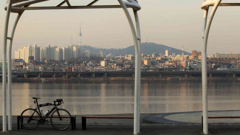 Bike along the Hangang River with Namsan Tower in the background.