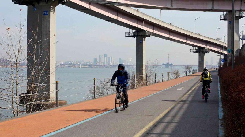 Bike riders along the Hangang Bike Path in Seoul.