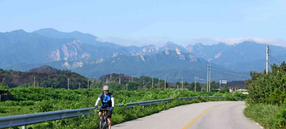 A picture of a bike rider along the East Coast Bicycle Path in Korea.